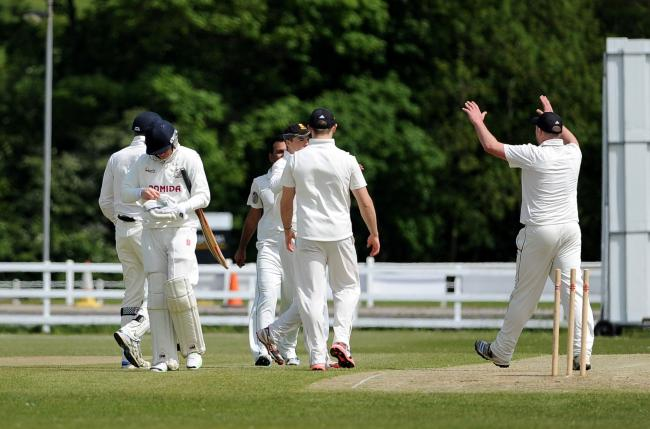 Bradford & Bingley celebrate the dismissal of Woodlands opener Duncan Snell for a top score of 34 but Woodlands went on to log a narrow four-run win – Picture: Anthony McMillan