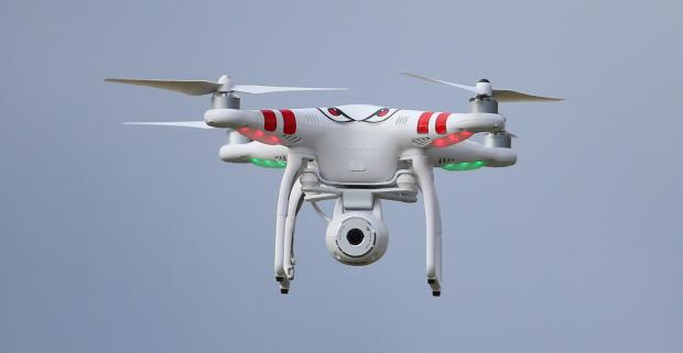 Bradford Telegraph and Argus: A quadcopter type drone with a camera