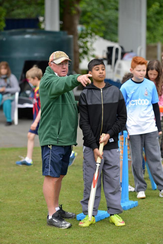 Billy Ricketts coaches for Saltaire Cricket club at a children's cricket  event in Roberts Park