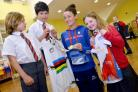 World Champion cyclist Lizzy Armistead visited schools in Otley and met children to discuss her recent success, Lizzy and mad keen cyclist Isobel Wilkes with two of Lizzy's shirts