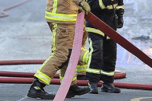 Fire crew called to burning tyres on unoccupied land near houses
