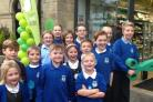 Oakworth Primary School pupils cut the ribbon at the reopening of the village Co-op store