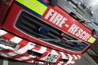 Fire service rescues casualty from a car following collision