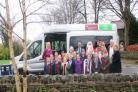 Pupils at Birkenshaw CE Primary School join Santa with the new minibus