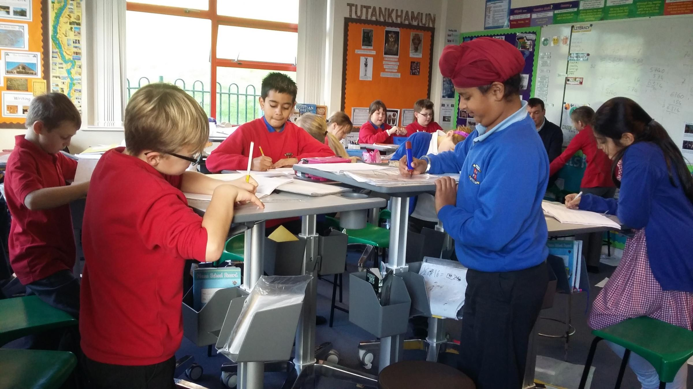 RESEARCH: Pupils at Grove House Primary School try out the new sit-to-stand desks