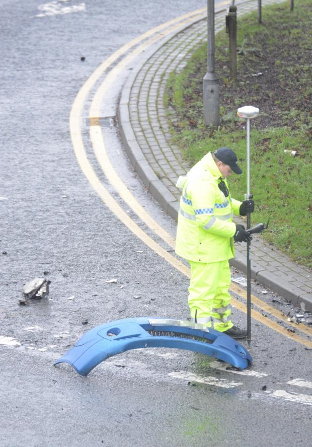 Bradford Telegraph and Argus: A police investigator at the scene