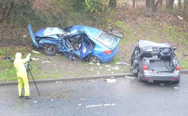 Bradford Telegraph and Argus: Police at the scene of the crash