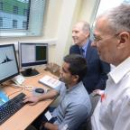 Bradford Telegraph and Argus: Research technician Sadr Ul Shaheed, centre, senior lecturer Dr Chris Sutton, front, and Professor Laurence Patterson, back, at the Institute of Cancer Therapeutics at the University of Bradford
