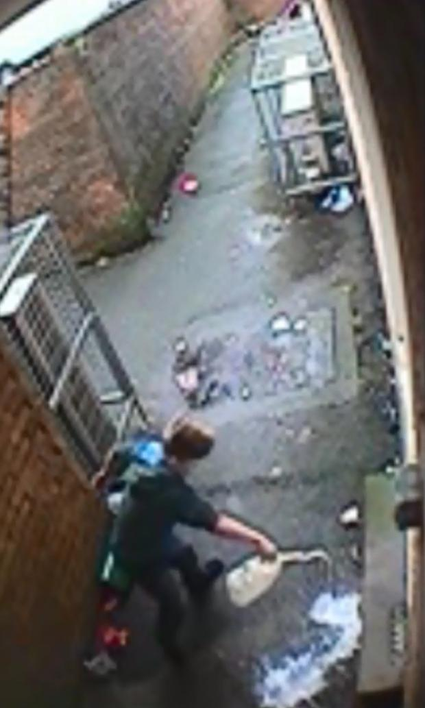Bradford Telegraph and Argus: CCTV footage shows a boy pouring milk on the ground outside East Ward Labour Club