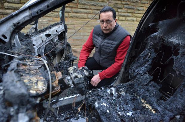 Bradford Telegraph and Argus: Jeeta Heer with the burned remains of his Ford Escort van