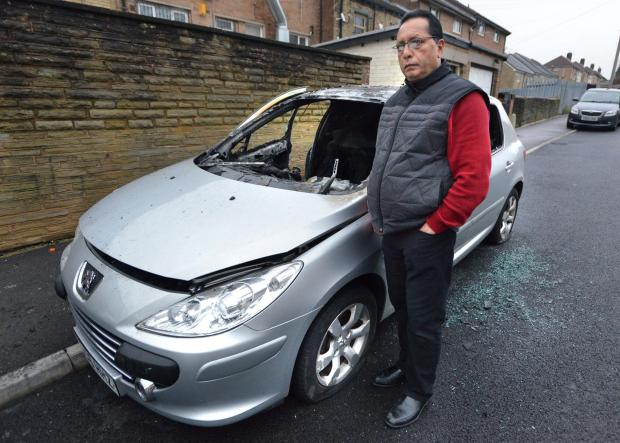Bradford Telegraph and Argus: Jeeta Heer with his fire-damaged Peugeot