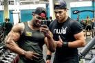 IN THE GYM: Charlie Martin, right, with bodybuilding champion Azeez Salu