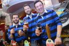 Barmen at Ilkley and District Round Table's Beer Festival raise a glass