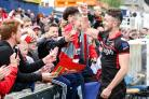 Ryan Brierley celebrates with Leigh supporters after his side won at Wakefield in the Challenge Cup last season