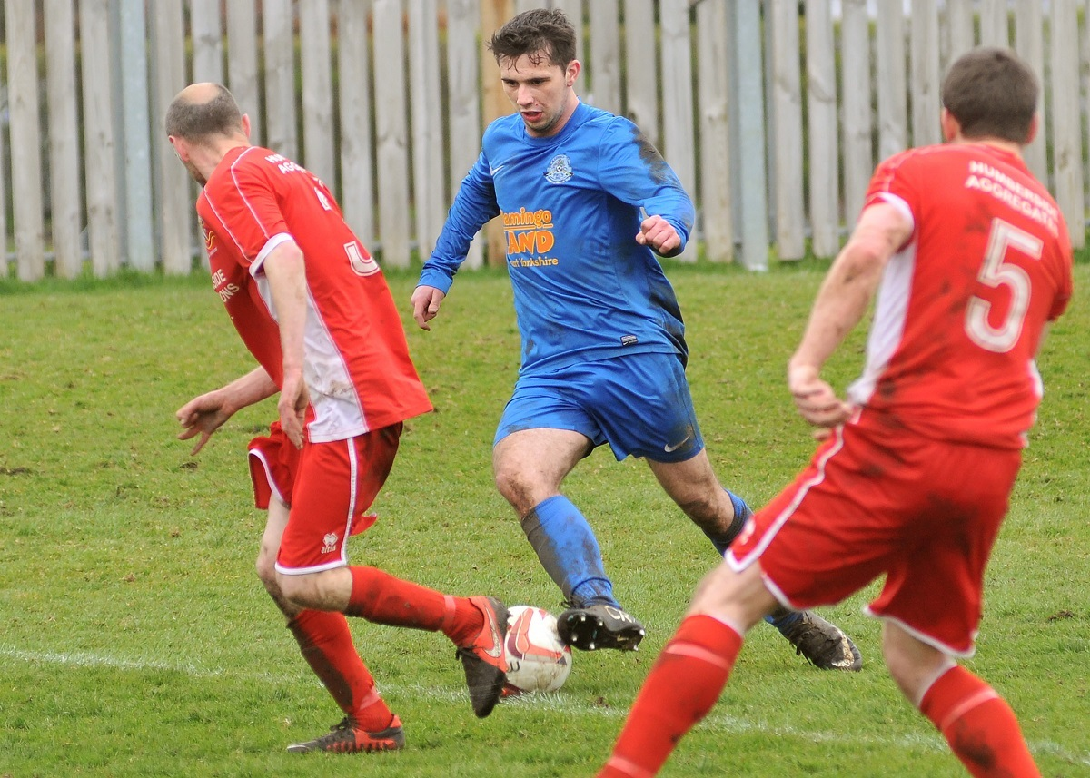 Pickering Town v Bridlington. Pictured in action is Pickering's Mitch Hamilton weaves through the defenders and scores. Picture David Harrison..