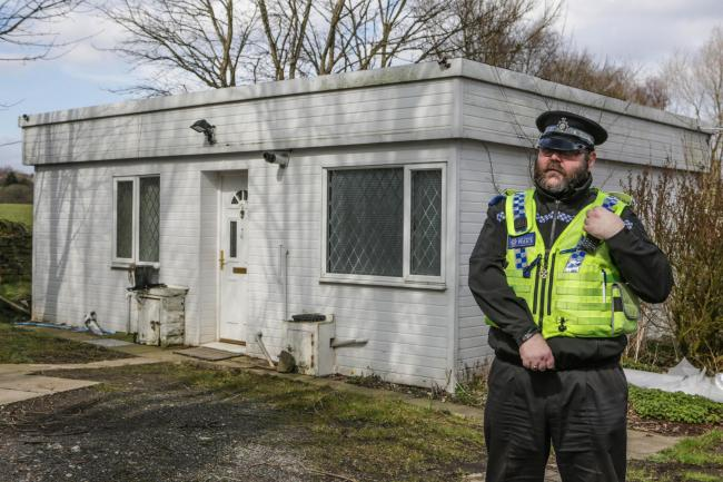 A police officer outside the property where Marie Johnston was found on Saturday