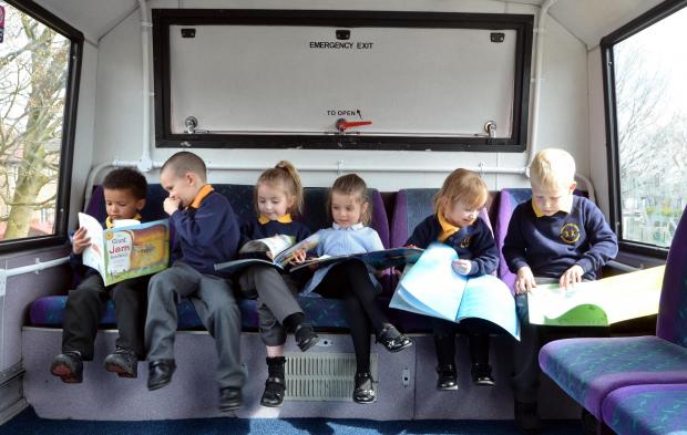 Bradford Telegraph and Argus: Farfield Primary School pupils get a sneak peek of its unusual new library, an old First Bus