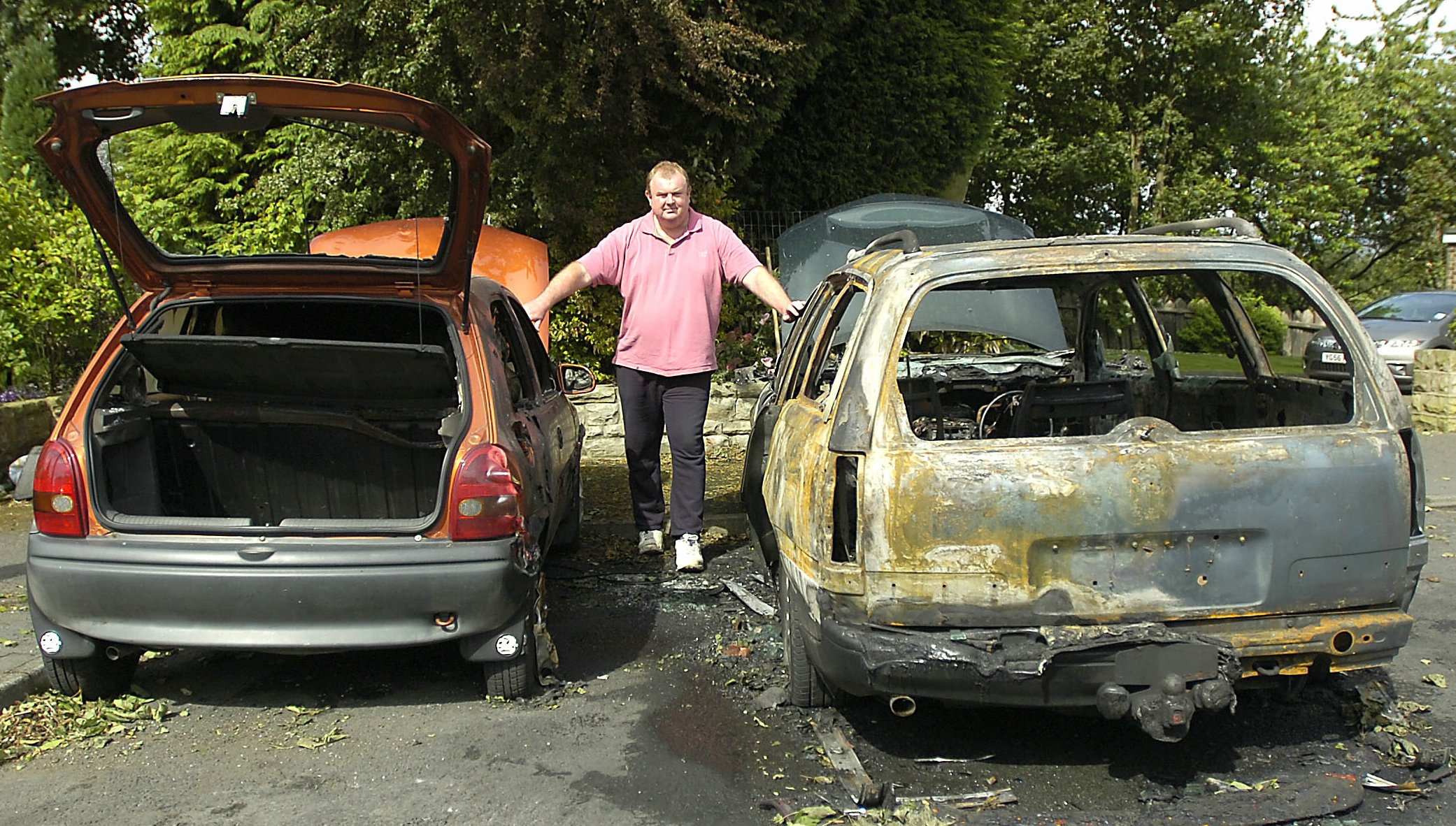 Steve Tiffany with his burned-out Vauxhall Corsa, left, and Omega