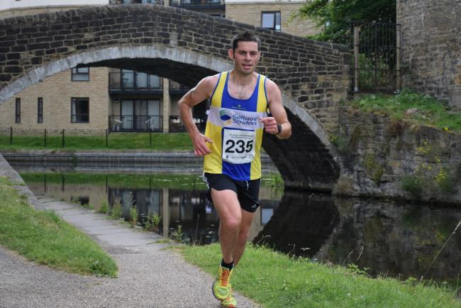 Saltaire Striders' Will Kerr helped Ben Smith towards his target of 401 marathons in 401 days Picture: Dave Woodhead