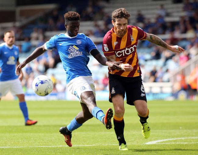 MIXING IT UP: Romain Vincelot, pictured right in action against Peterborough's Leonardo Da Silva Lopes, is pleased at City's ability to play in different ways