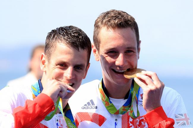 Great Britain's Alistair and Jonny Brownlee with their gold and silver medals in Rio