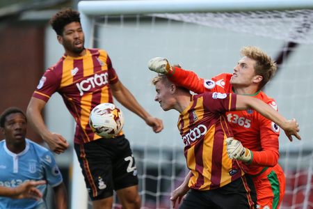 Reece Webb-Foster, centre, in action for the Bantams in last week's Checkatrade Trophy clash against Stoke City Under-23s, has joined Guiseley on a one-month loan deal