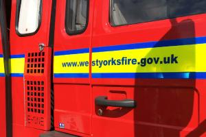 Two treated by ambulance crew as fire rips through roof of house
