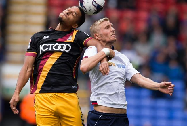 Timothee Dieng outjumps Bolton's Dean Moxey. Pic: Bolton News