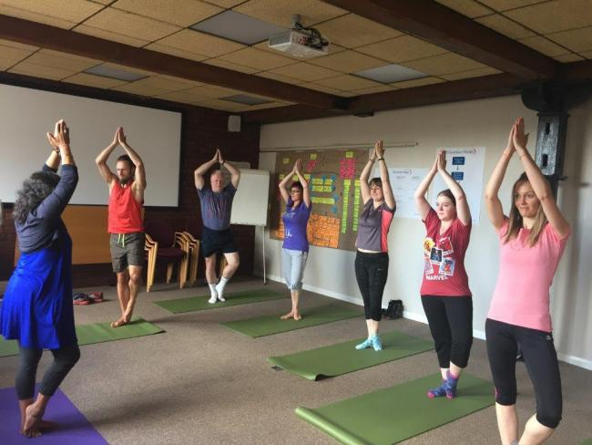 WELFARE: Christeyns staff taking part in a yoga session