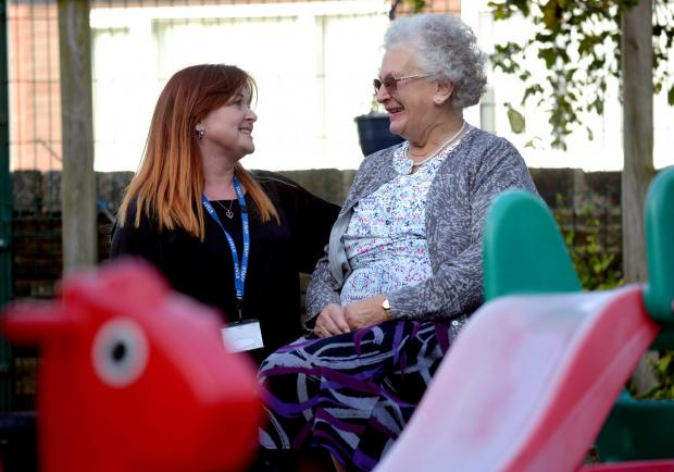 Bradford Telegraph and Argus: Ahead of Wibsey Methodist Pre-School's 50th birthday celebrations. Founder Audrey Frost (right) chats with current manager Michele Arundell
