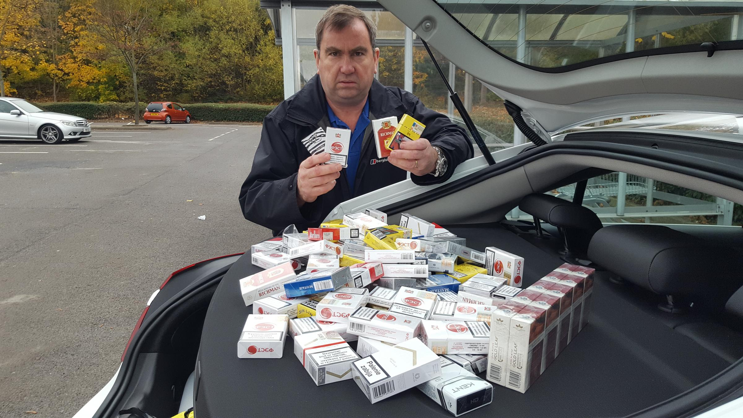 Will O'Reilly with some of the illicit cigarettes obtained during test purchases in Bradford
