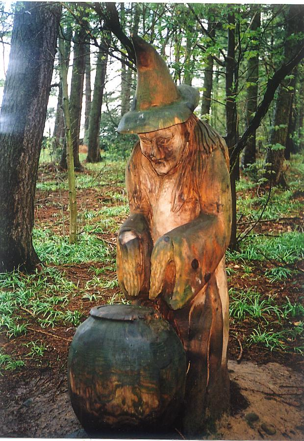 A wooden witch casts a spell in the St Ives woods