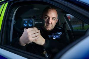 Sgt Cameron Buchan using a mobile speed camera