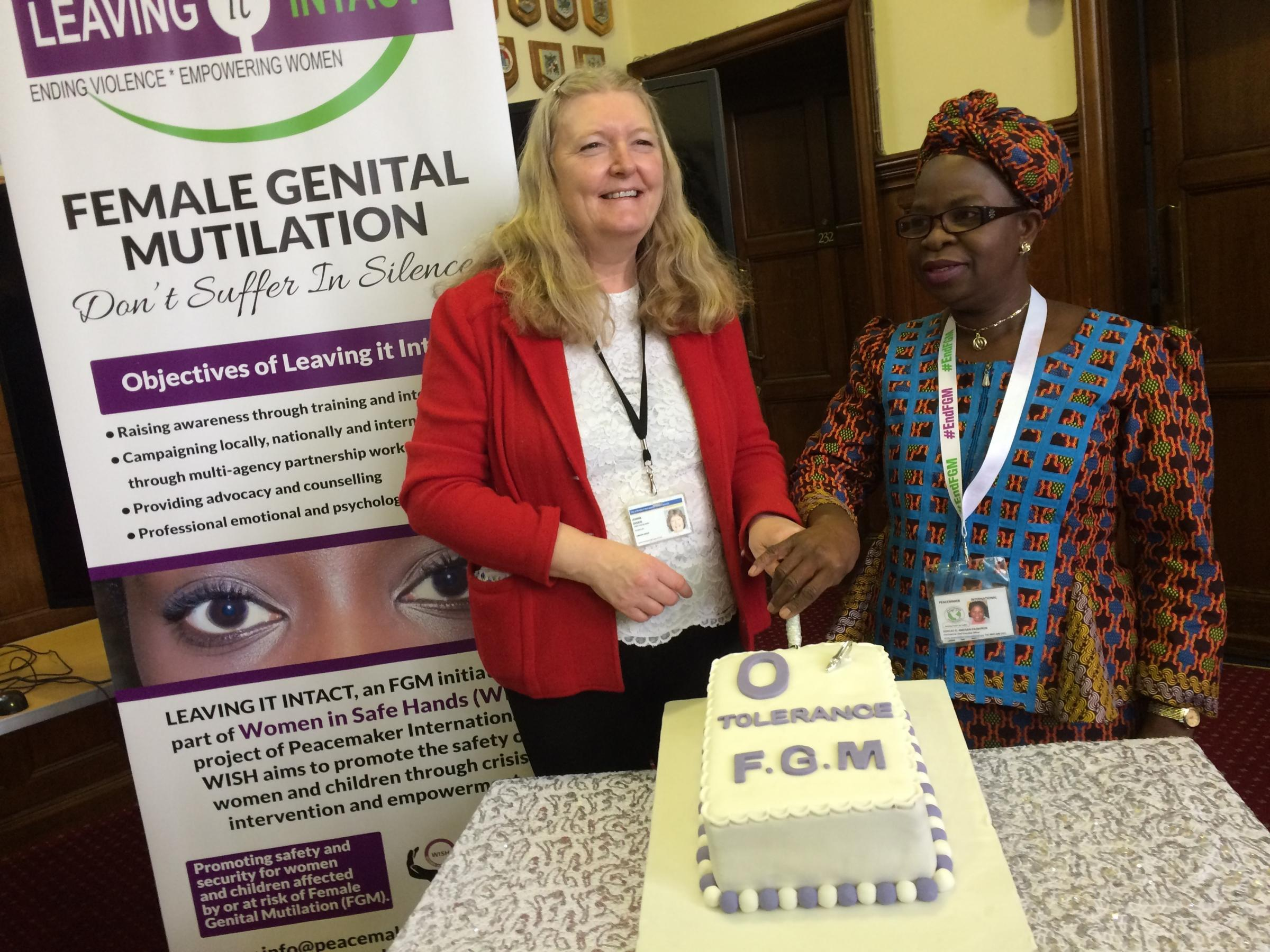 Cllr Joanne Dodds and Yemi Fagborun, of Peacemaker International, cut the 'zero tolerance to FGM' cake