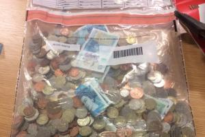 The cash seized by police in what they suspect is a bogus charity collections cam