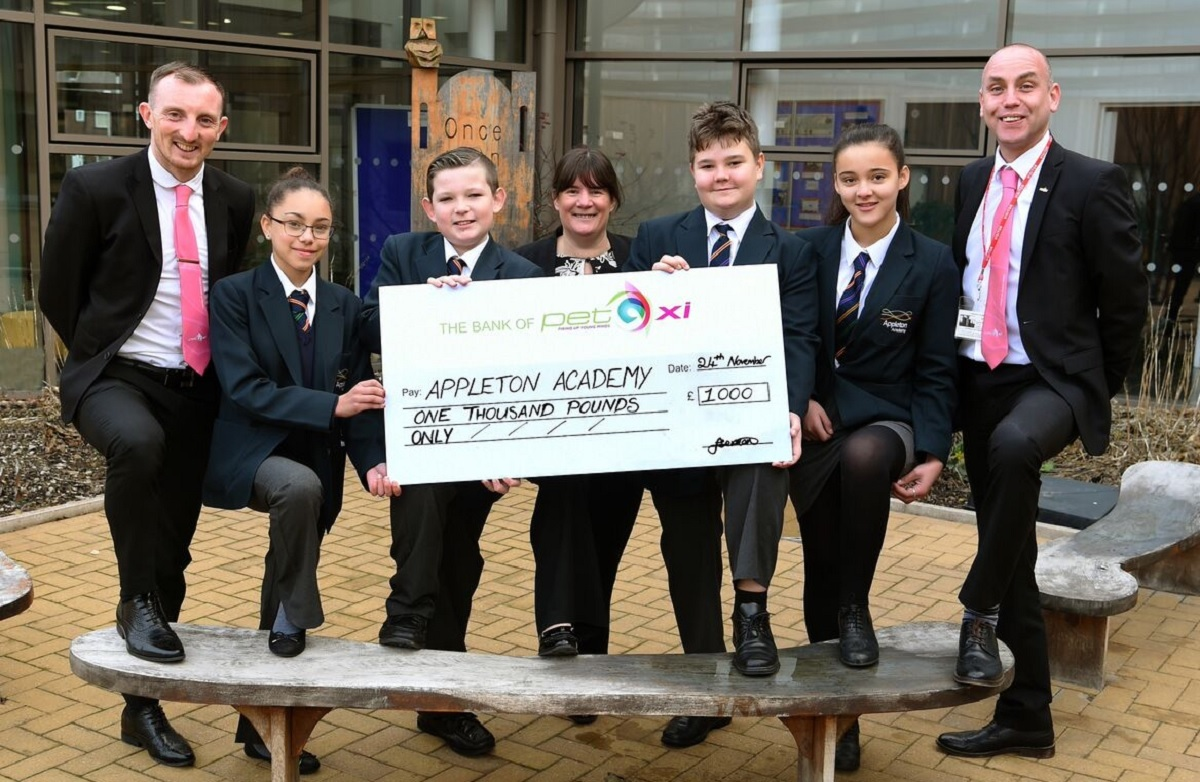 Appleton Academy pupils Amelai Wood, Matthew Marsh, Jakub Sulowski and Kellice Inwood and their vice principal, secondary, Rachel Garlick (centre) with PET-Xi's Contract Development Manager Gary Drake (far left) and Business Development Manager Steve Sm