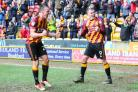 Tony McMahon celebrates a remarkable City turnaround with Charlie Wyke. Pictures: Thomas Gadd