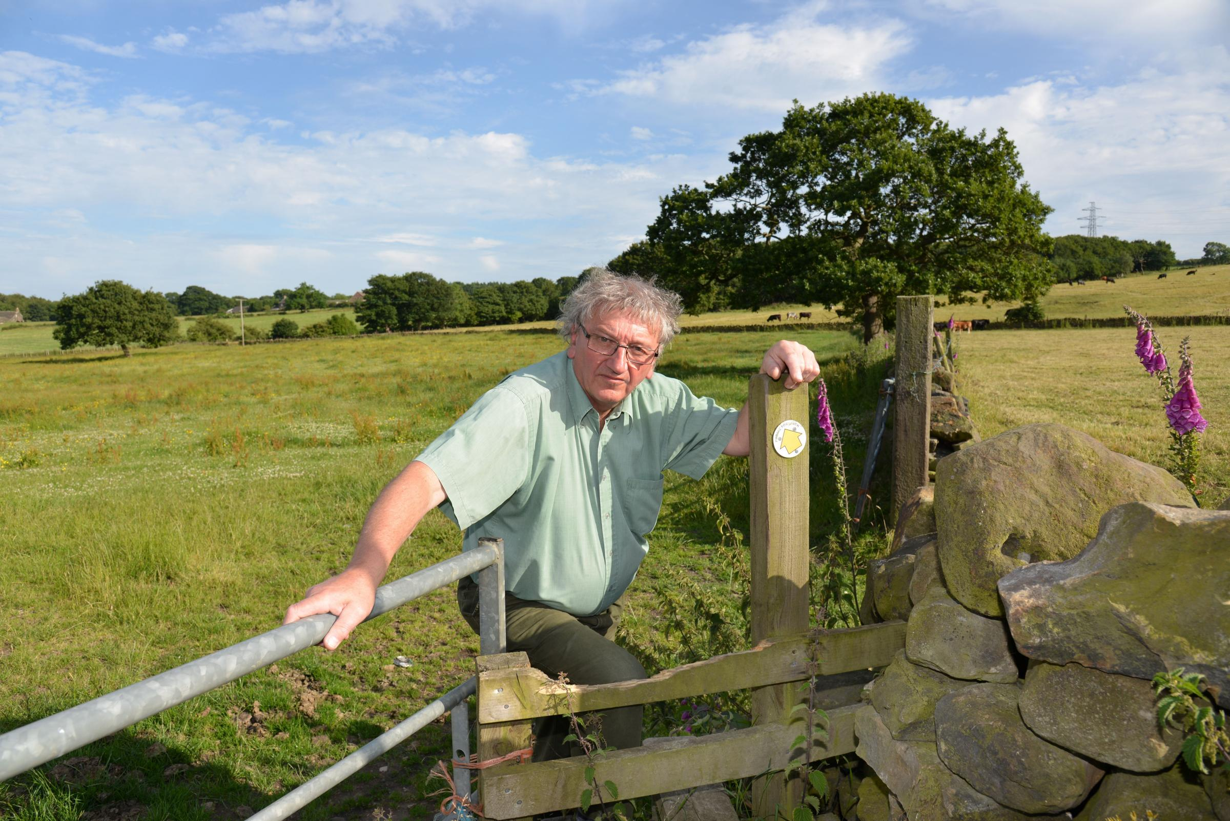 FRESH HOPE: The Rev Canon Gordon Dey looking over Green Belt land in the Tong Valley