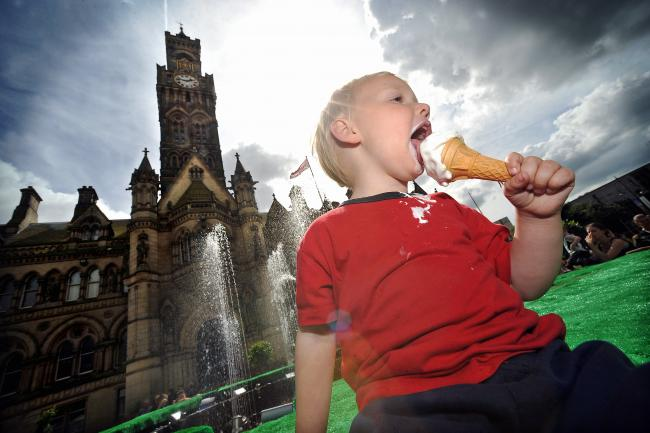 Caiden Spencer enjoys an ice cream in the City Park