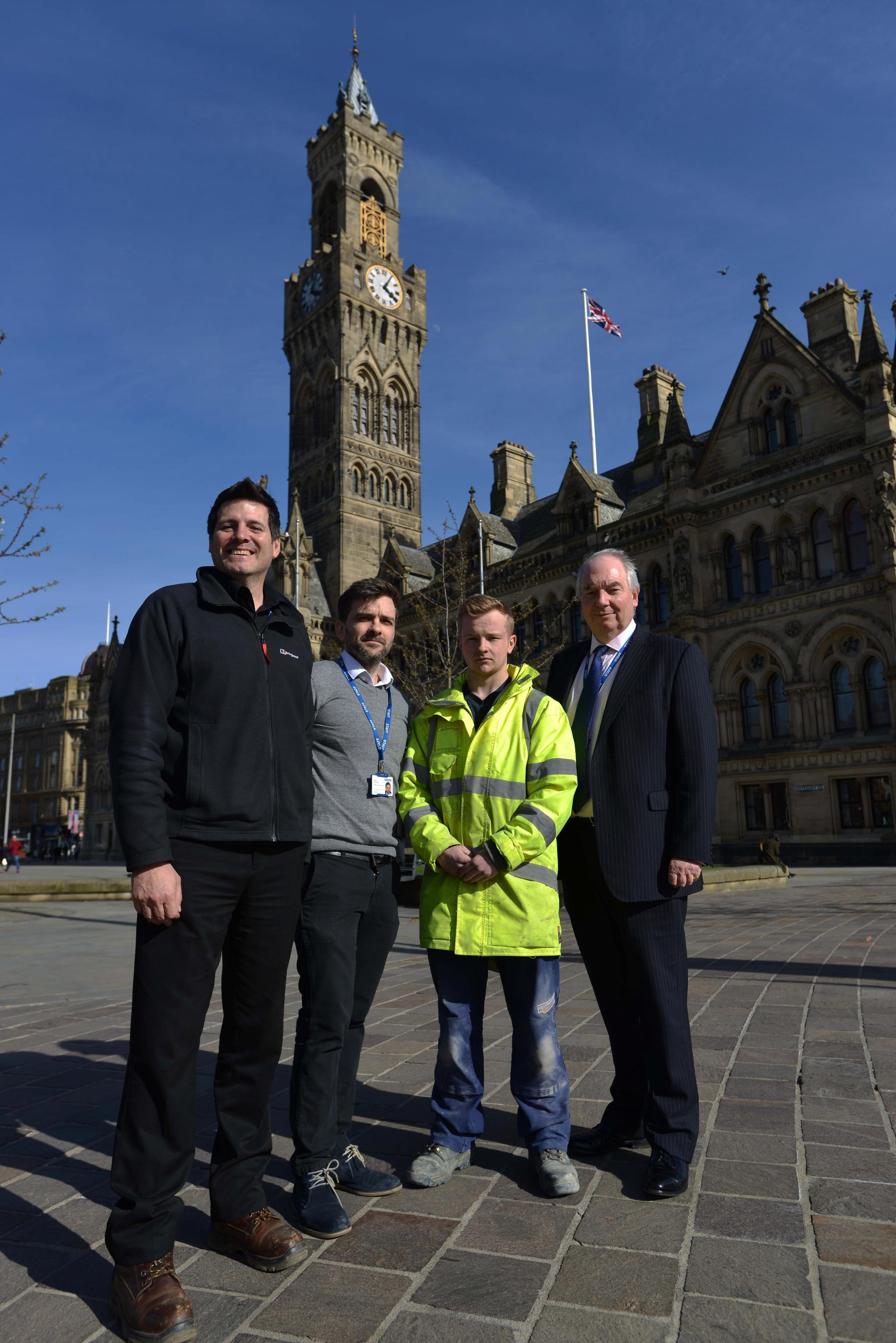 Steve Aldeguer, project manager, Julian Chancellor, senior building surveyor, Billy Aykroyd, apprentice bricklayer, and Ben Middleton, assistant director for estates and property, in front of City Hall after its £4 million restoration is completed