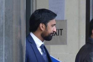 Dr Fesal Hussain leaving Bradford Crown Court during his trial
