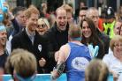 Kate, William and Harry give royal thumbs-up to marathoners