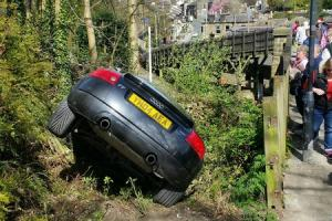 The Audi TT Quattro that became embedded in vegetation overlooking the Keighley and Worth Valley Railway at Haworth station. Picture by Tim Moody