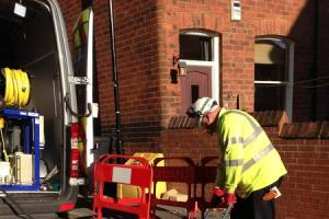 A Yorkshire Water worker pressure jetting a blocked sewer