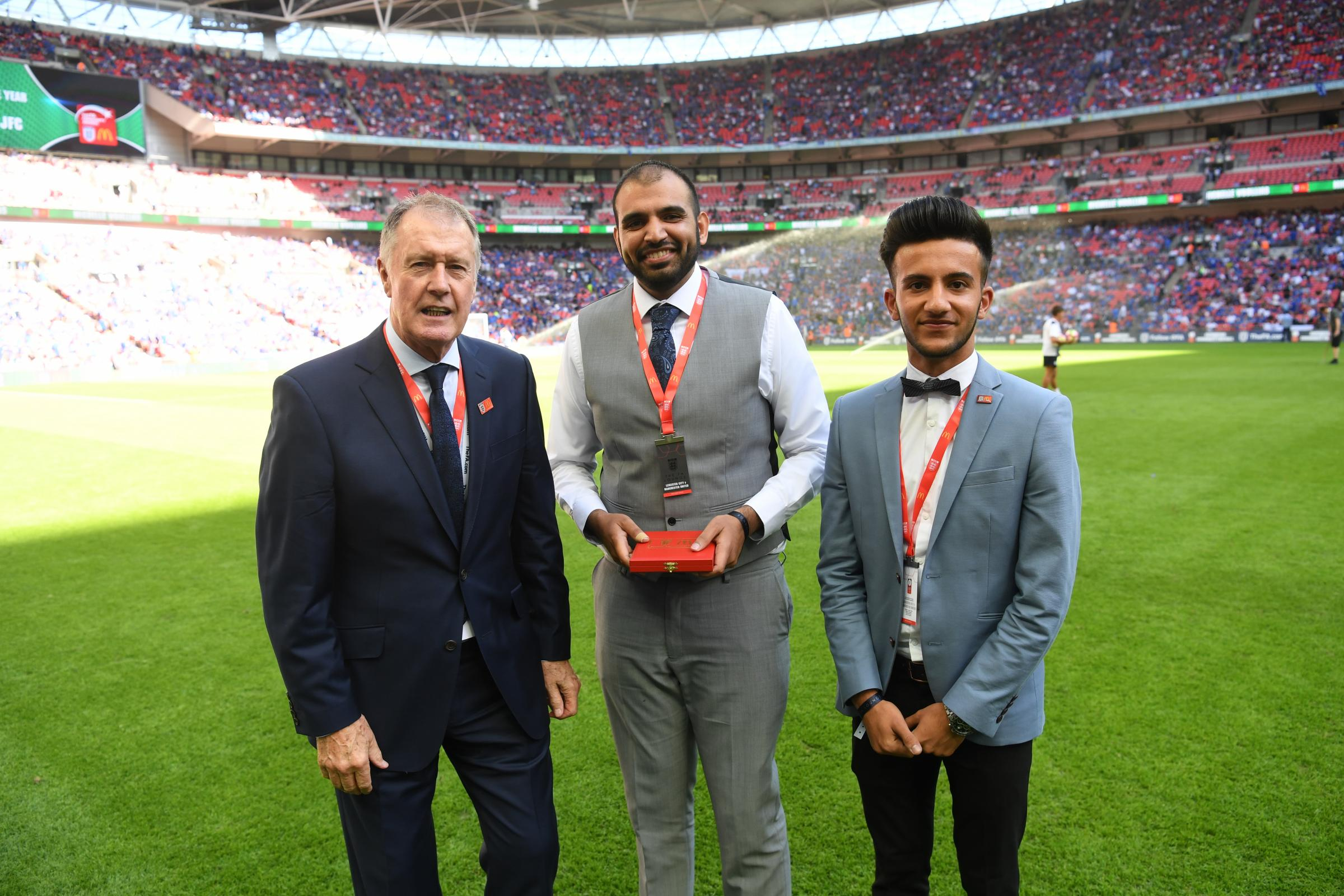 Alpha United Juniors, collecting their FA club of the year award from Sir Geoff Hurst, need more volunteers at training and on match-days