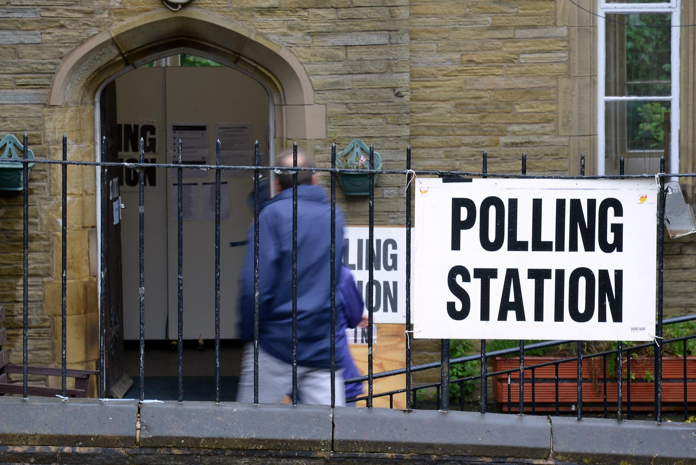 Voters arrive at a polling station in Shipley