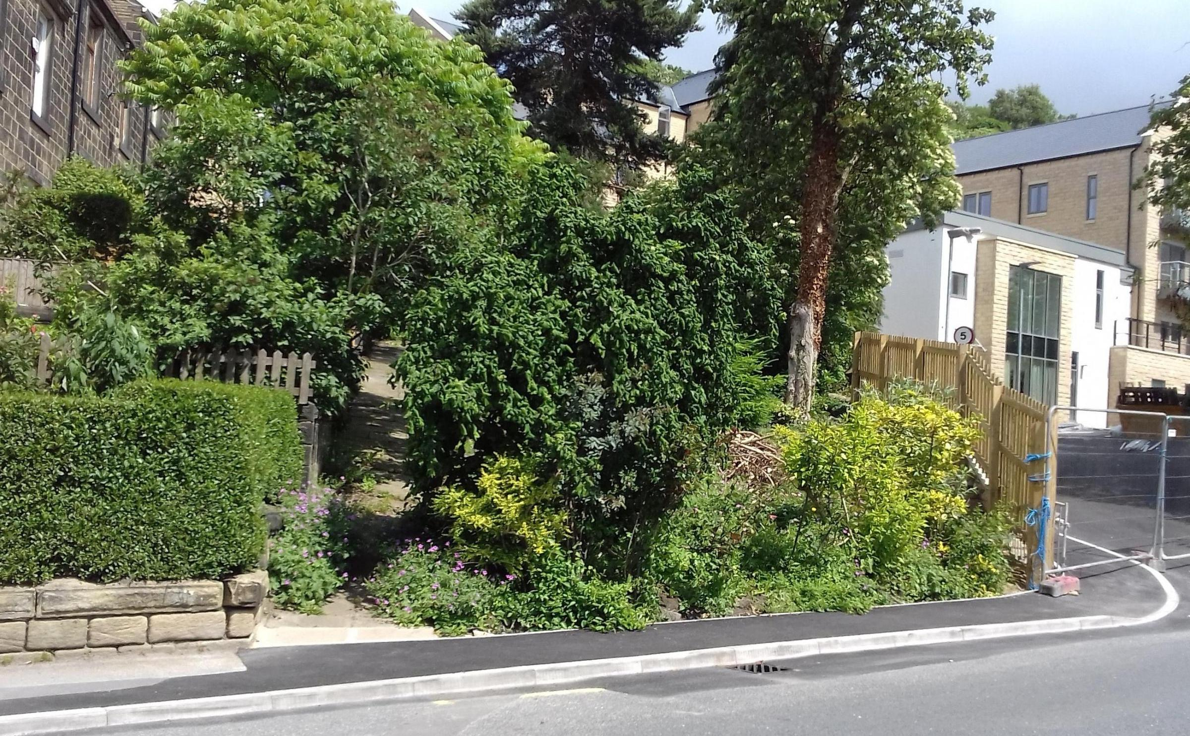 ANGER: Residents of Fernbank Avenue, Bingley, want builders Abbeyfield to fully replace a wooden fence