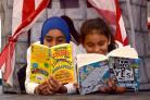 Amina Ali and friend Hanyah Khan, 10, at the start of last year's Summer Reading Challenge