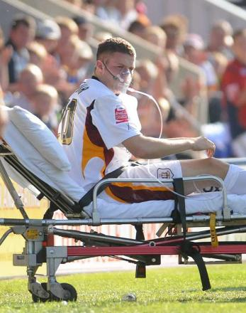 TJ Moncur receives oxygen on the pitch before being taken to hospital