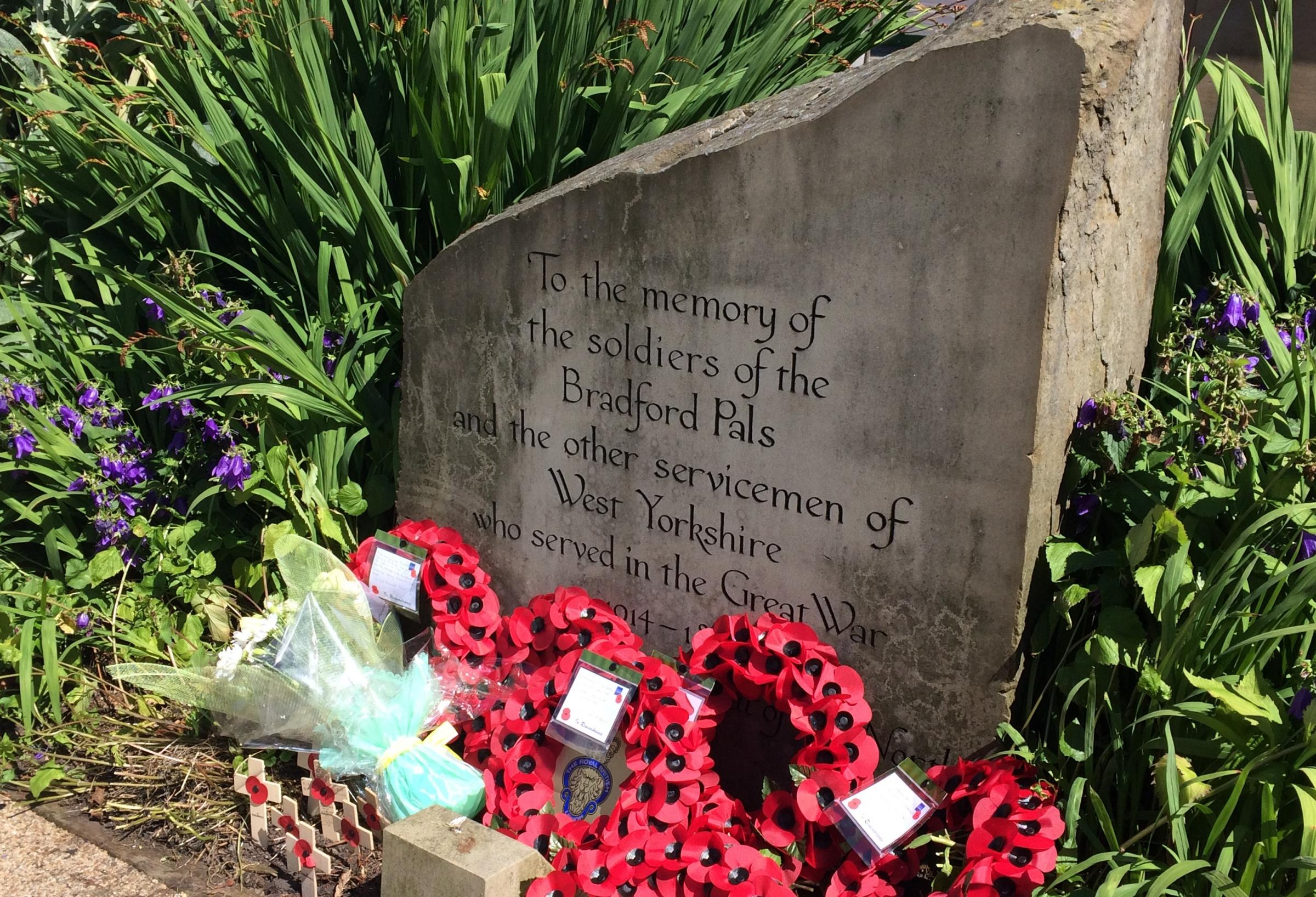 Wreaths placed earlier this month at the Bradford Pals memorial